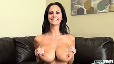 Ava Addams squeezes her huge melons and diddles her twat on the couch