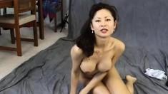 Sensual Asian girl with big boobs Maya Chung exposes her tight peach
