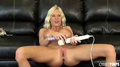 Riley Evans moans as she uses a magic wand on her sensitive clit