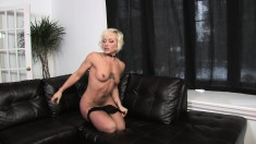 Horny blonde cougar with a superb ass Denise masturbates on the couch