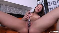 Sweet brunette Dani Daniels does a striptease and a dildo fucking