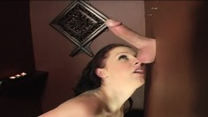 Bodacious redhead Gianna Michaels works her lips on a gloryhole stick