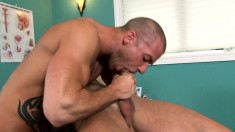 Horny guy has a hung stud plowing his anal hole in the doctor's office