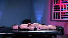 Restrained stud is tortured with a vibe and anal sex in an M2M bondage scene
