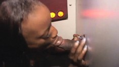 Ebony cutie with a perky ass gets covered in hot cum at the gloryhole