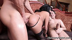 Busty bitch in corset and stockings gets slammed by two guys at once