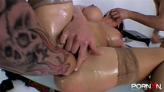 Now a fist goes deep into her pussy and she gets her butt hole fucked