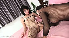 Suzi and another fishnet clad shemale suck cock and bang some ass