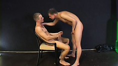 He pounds him in a chair and cums on his back, then they trade off