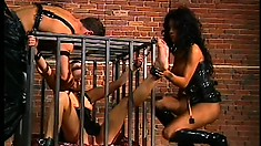 Caged slut Aurora Snow is getting tortured by her masters and mistress