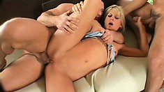 Attractive blonde has two studs fucking her pussy and filling her mouth with jizz