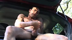 Vulnerable guy lies in boat and caresses his amazingly strong cock