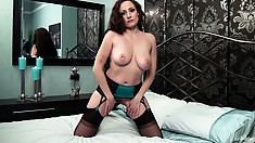 Busty brunette in lingerie undresses, spreads wide and touches herself