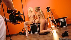 Two sexy blondes get ready to participate in a hardcore shoot