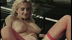 Two busty cougars, a brunette and a blonde, explore their lesbian desires on the bed