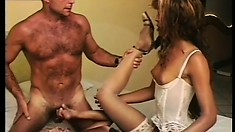 Two sensual shemales in lingerie seduce a hot stud for a wild threesome