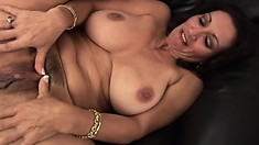 Lovesome mature babe Persia demonstrates her fake boobs and gets rubbed