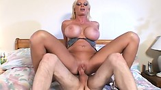 Sexy Carson pushes her big titties together as she gets fucked