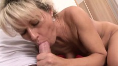 Sexy slim mature blonde gets fucked hard by a young guy on the couch