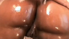 Curvy black babe gets her ass oiled up, blows and gets her twat hammered