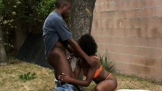 Cute chocolate girl with perky tits fucks a black cock in the backyard