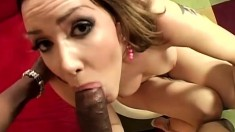 Horny redhead has a great time riding a black rod of pleasure
