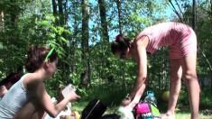 Tow young babes have a blast going into the woods in the nude