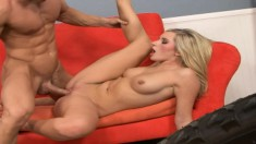 Delightful blonde Kylie Reese lies on the couch and gets banged hard