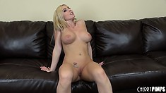 Busty blonde Christie Stevens plays with her pussy and does some posing