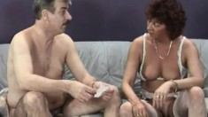 Horny redhead milf in white lingerie gives a nice blowjob on the couch