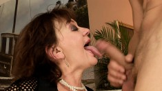 Seductive mature lady does everything to her young lover's big stick