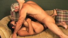Hunky brunette boy has a gorgeous blonde stallion hammering his ass