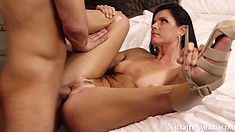 India Summer takes it to the base with her tight tanned pussy