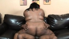 Curvy ebony woman with massive hooters feeds her hunger for black meat