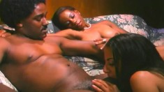 Hung black stud deeply drills two seductive ebony girls on the couch