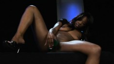 Ebony beauty with lovely tits fucks herself to pleasure with sex toys