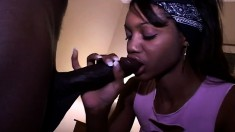 Little ebony blows a big black dick and gets nailed from behind