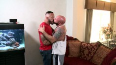Two muscled and tattooed thugs get down for hot oral and anal sex on the couch