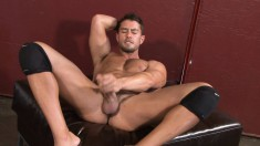 Sexy stud with a fantastic body Cody pleases himself for the camera
