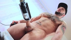 Inked stud loves to stick his colossal piece of man meat into a sex toy