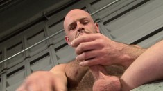 Muscular hairy stud fingers his butt hole and fucks himself with a smooth metal toy