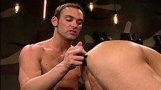 Sexy stud with a long prick fists the hell out of his cute lover's ass