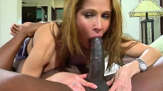 Big MILF boobs and a black cock