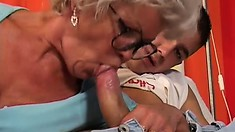 Granny with many nasty toys gives a young lad a sloppy blowjob