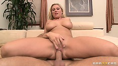 Jumping on top, the gorgeous blonde rides her neighbor's dick with enthusiasm