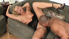 Delightful blonde with big boobs and sexy legs surrenders her peach to a black stud