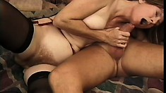 Lustful mature woman in sexy lingerie rides a honry guy's hard cock with passion