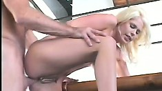 Platinum blonde housewife sends hubby off to work with a smile on his face