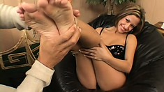Stunning brunette with nice long legs gives her man a footjob