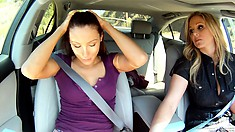 Two young lesbians park their car to have sex in the backseat